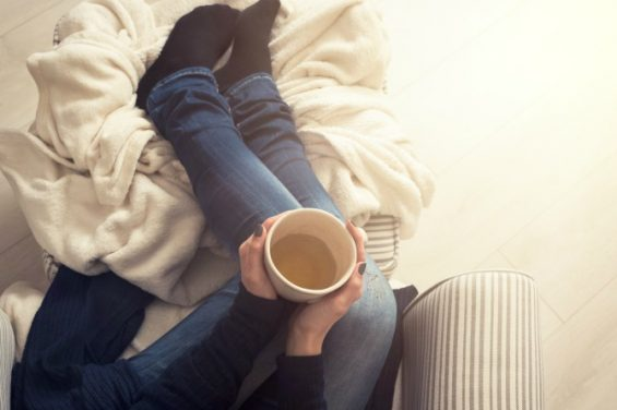 woman-couch-winter-tea-cosy_feature-565x376